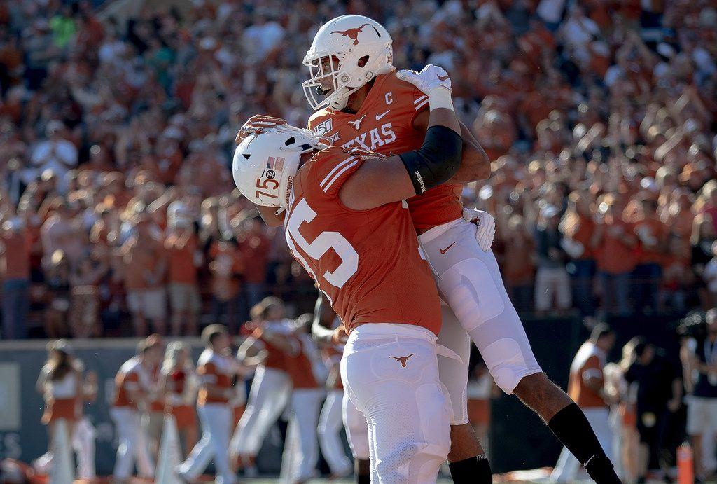 Texas wide receiver Collin Johnson (9) celebrates a touchdown against Kansas State reception with offensive lineman Junior Angilau (75) during an NCAA college football game Saturday, Nov. 9, 2019, in Austin, Texas. (Nick Wagner/Austin American-Statesman via AP)