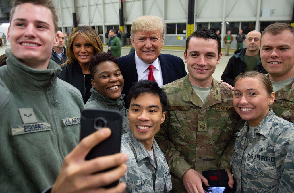 President Donald Trump and first lady Melania Trump greet members of the United States military during a stop at Ramstein Air Base in Germany, on December 27, 2018.