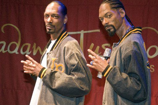 Snoop Dogg, left, stands next to his wax figure at Madame Tussauds Las Vegas.