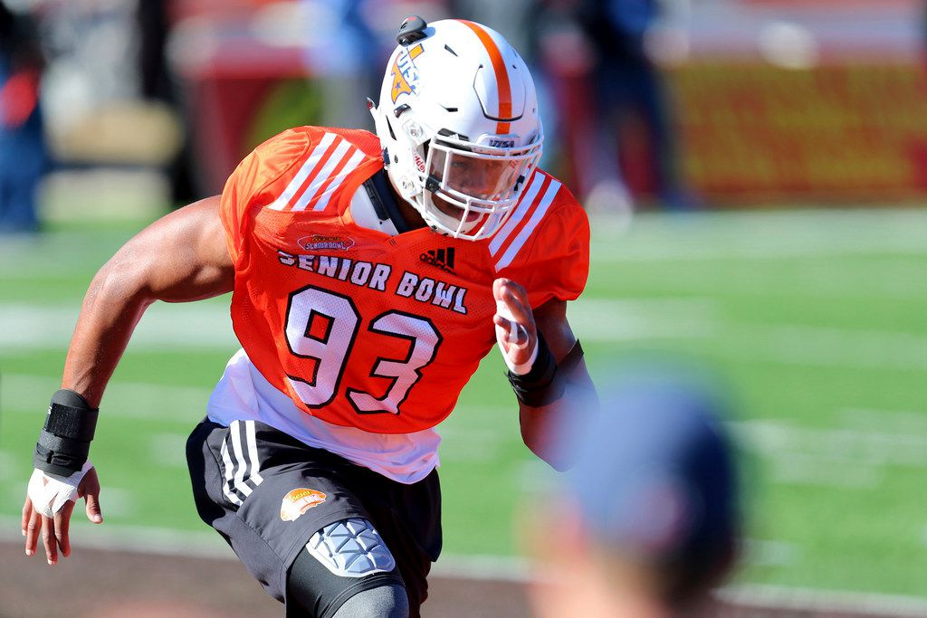 FILE - In this Jan. 23, 2018 file photo, South Squad defensive end Marcus Davenport, of UTSA, runs drills during the South's practice in Mobile, Ala., ahead of the Senior Bowl. The 6-foot-6, 259-pounder was one of the top NFL prospects at the Senior Bowl, rated as a potential first-rounder and maybe even a top-10 pick. (AP Photo/Butch Dill)