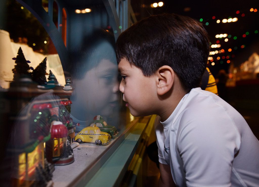 Nathan Reyna, 5, of Dallas, places his nose against glass as he watches the trains roll by at the Trains of NorthPark Holiday Attraction, Monday Nov. 26, 2018 in Dallas. Ben Torres/Special Contributor
