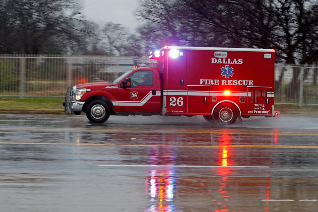 A Dallas Fire-Rescue ambulance headed to a call on a cold rainy morning in Dallas on Jan. 2, 2019.