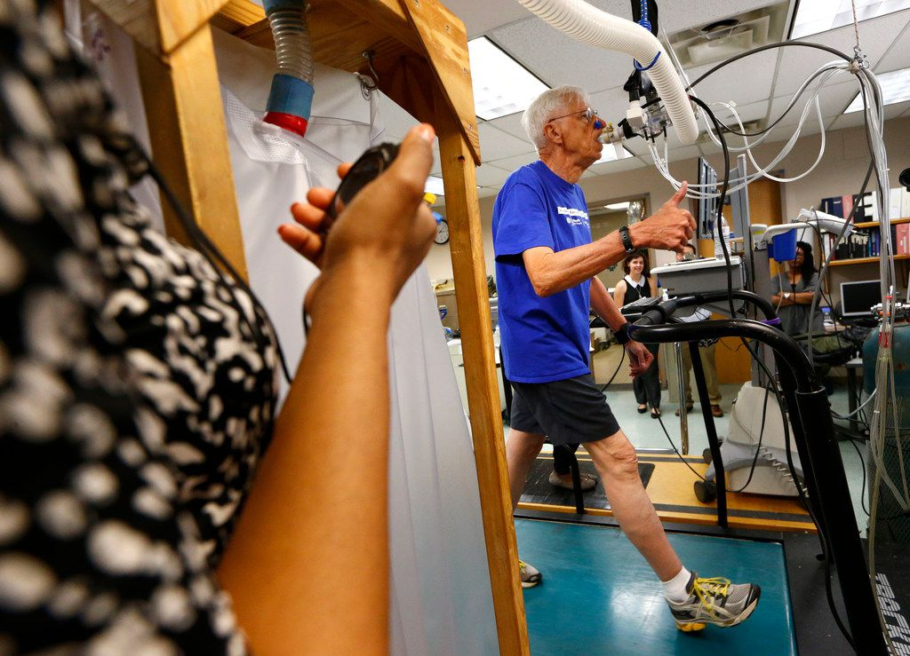 Richard Rahn gives the thumbs-up during a treadmill stress test at the Institute for Exercise and Environmental Medicine in Dallas on May 23, 2018. The Alzheimer's Disease Center at UT Southwestern Medical Center is leading a national clinical trial to gather evidence that aerobic exercise and anti-hypertension medication, or a combination of both, can benefit brain health.
