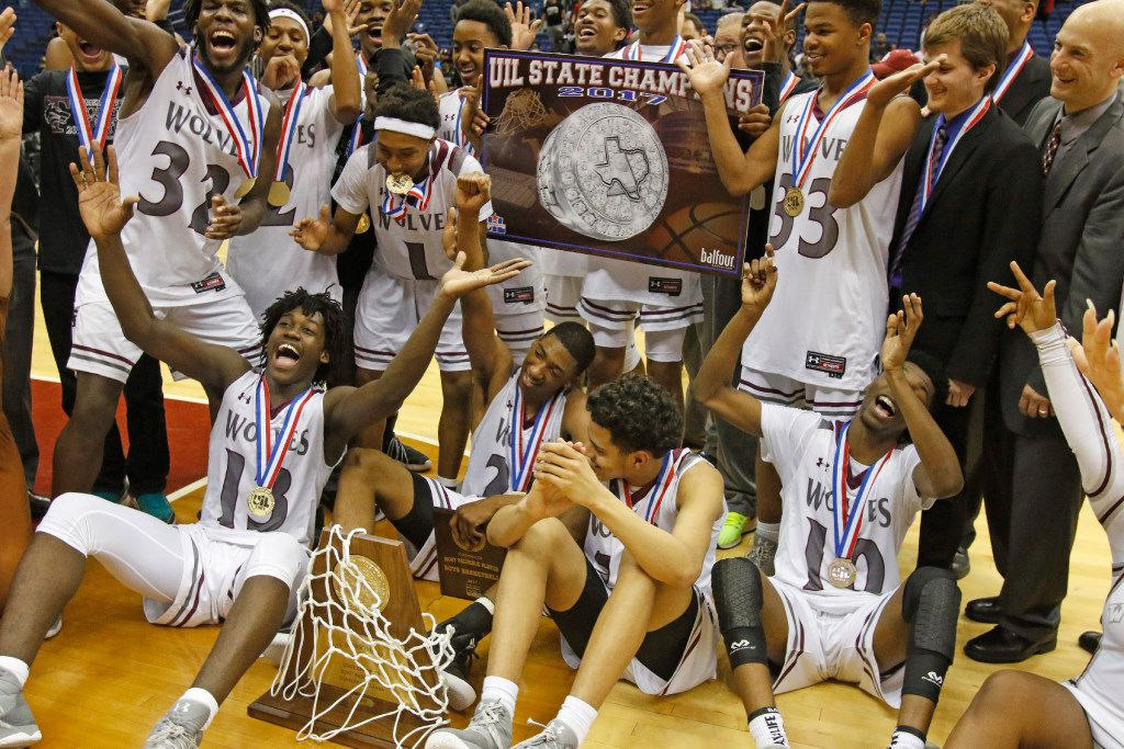 Mansfield Timberview's Isaac Likekele (front, lower left, 13) and his teammates pose for a group photo after winning Saturday's UIL Class 5A boys basketball final between Mansfield Timberview and Fort Bend Marshall on Saturday, March 11, 2017 at the Alamodome.  (Ronald Cortes/Special Contributor)