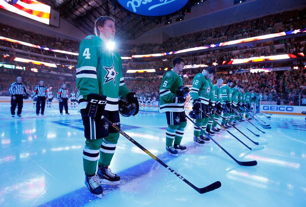 Dallas Stars defenseman Miro Heiskanen (4) lines up for the national anthem during the season-opening game at the American Airlines Center in Dallas, Thursday, October 4, 2018. The Stars were facing the Arizona Coyotes. (Tom Fox/The Dallas Morning News)