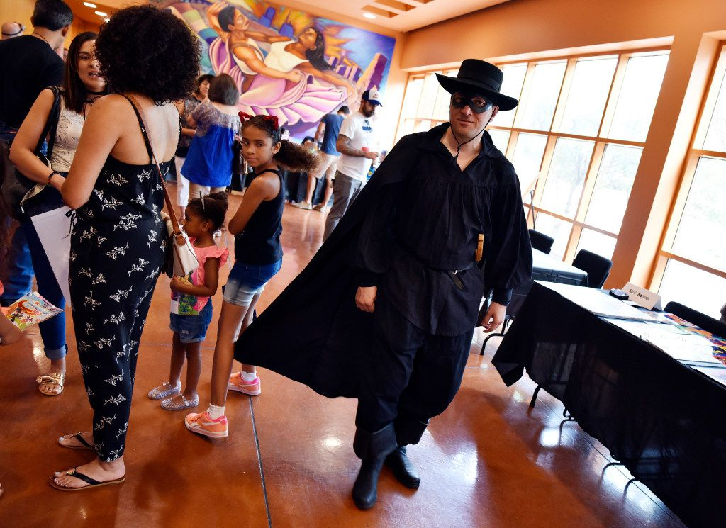 """Robert Goodrick, 39, sports a Zorro costume during the Texas Latino Comic Con held at the Latino Cultural Center in Dallas, Saturday, July 29, 2017. """"Zorro is the defender of the people,"""" said Goodrick about his costume. He grew up watching the swordsman hero with his grandpa. Ben Torres/Special Contributor"""