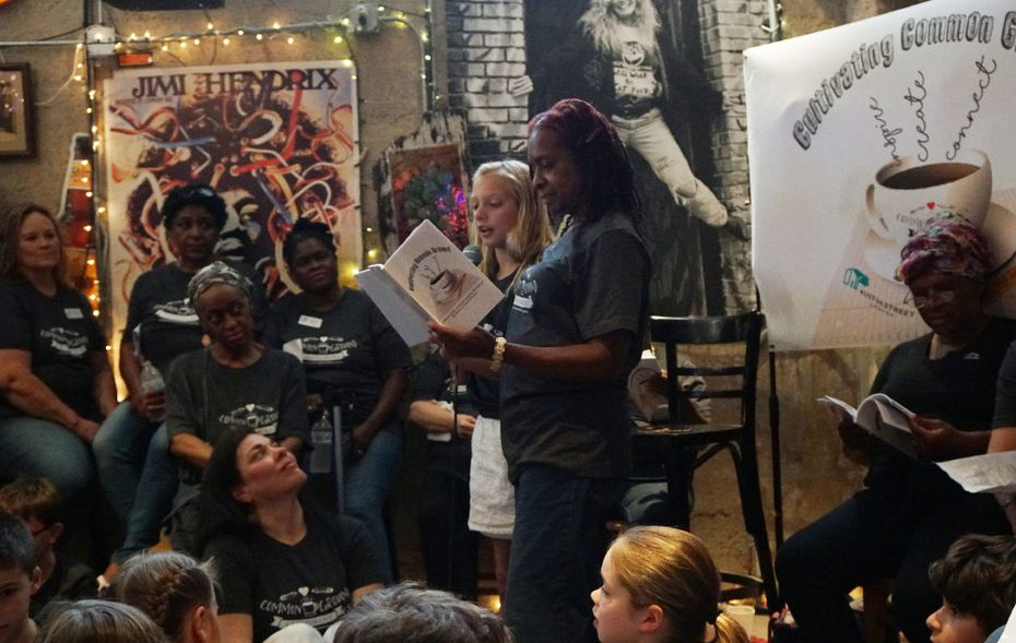 "Ella Nichols (10 years old) and Ernestine Slampa, center, read a poem during the ""Common Ground"" poetry reading at Opening Bell Coffee in Dalla."
