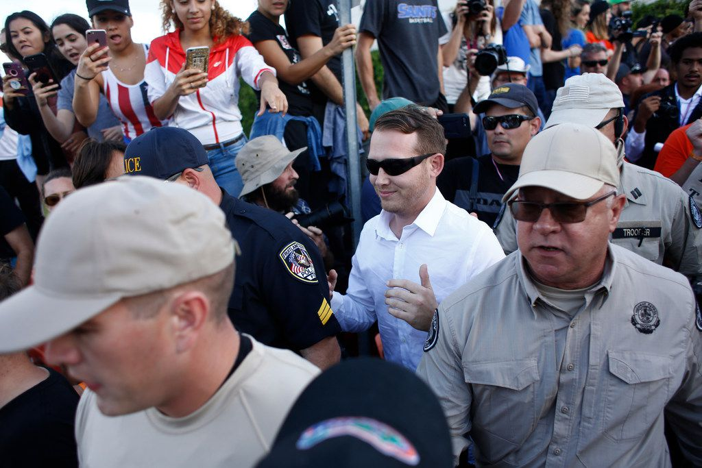 Self-described white nationalist William Fears, of Pasadena, Texas, center, walks behind Florida Highway Patrol troopers as the troopers assist his safe departure from a speech by Richard Spencer, who popularized the term 'alt-right',  at the University of Florida campus on October 19, 2017 in Gainesville, Florida. Fears was later arrested, along with his brother Colton Fears and friend Tyler Tenbrink, in relation to a shooting following the speech.