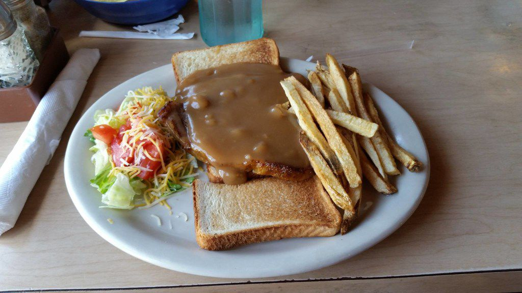 Open-face hot roast beef sandwiches are among the variety of dishes on the menu at Isaack Restaurant.