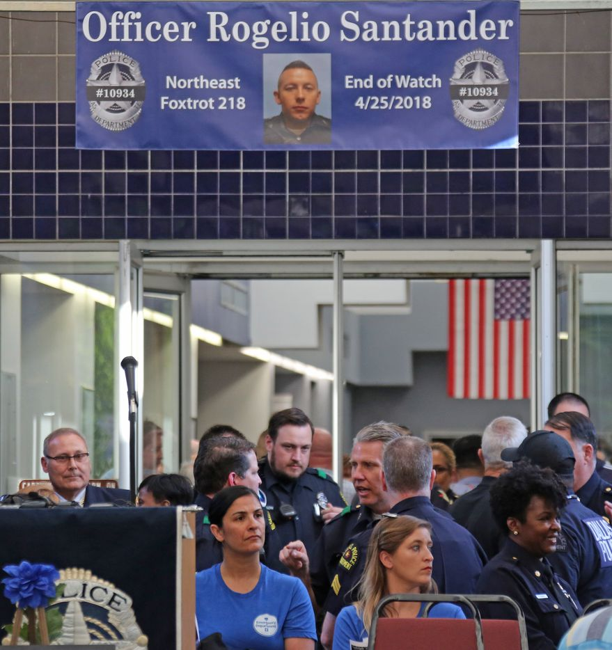 Officers and families gather at a candlelight vigil to support Dallas Police Officer Crystal Almeida, and to honor the memory of Officer Rogelio Santander, Jr., held at the Dallas Police Northeast Division substation on Thursday, April 26, 2018.