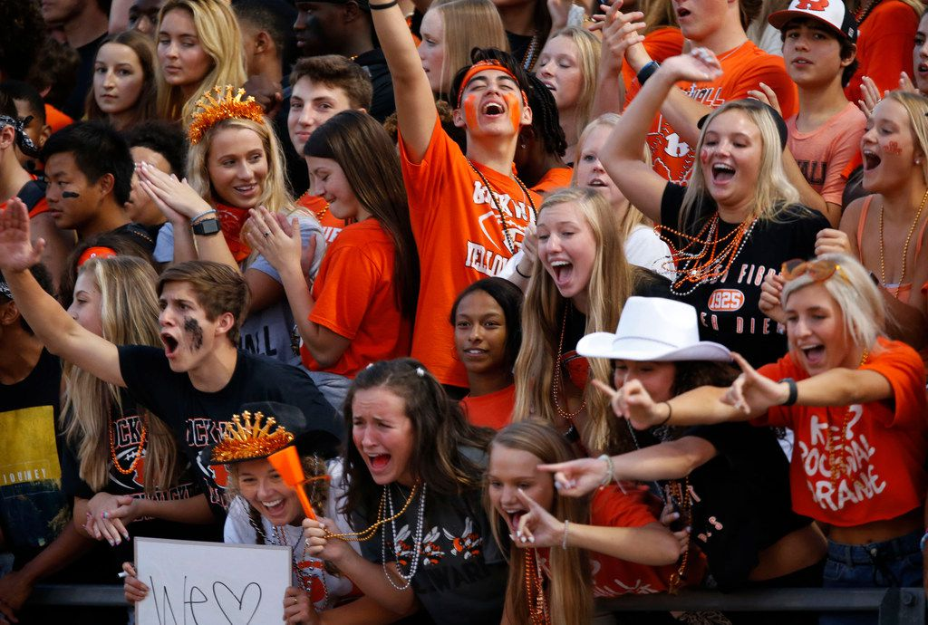 """Members of the """"Swarm"""" (Rockwall's student section) cheer on the team during the first half of a high school football game against  Highland Park at Wilkerson-Sanders Stadium in Rockwall on Friday, August 30, 2019. (John F. Rhodes / Special Contributor)"""