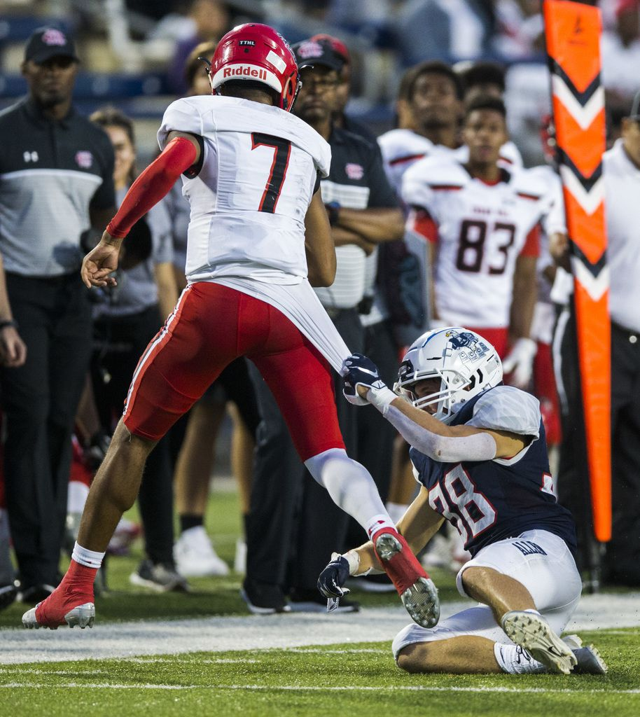 Cedar Hill quarterback Kaidon Salter (7) is taken down by Allen defensive back Will Drogosch (38) during the second quarter of a high school football game between Allen and Cedar Hill on Friday, August 30, 2019 at Eagle Stadium in Allen. (Ashley Landis/The Dallas Morning News)