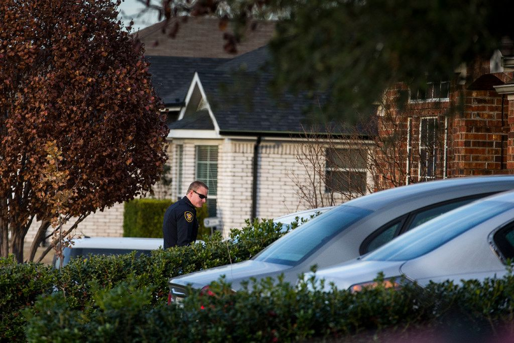 A Fort Worth police officer approaches the house of a neighbor whom Jacqueline Craig accused of assaulting son. Craig and her two daughters were arrested Wednesday by the officer who responded to Craig's 911 call.