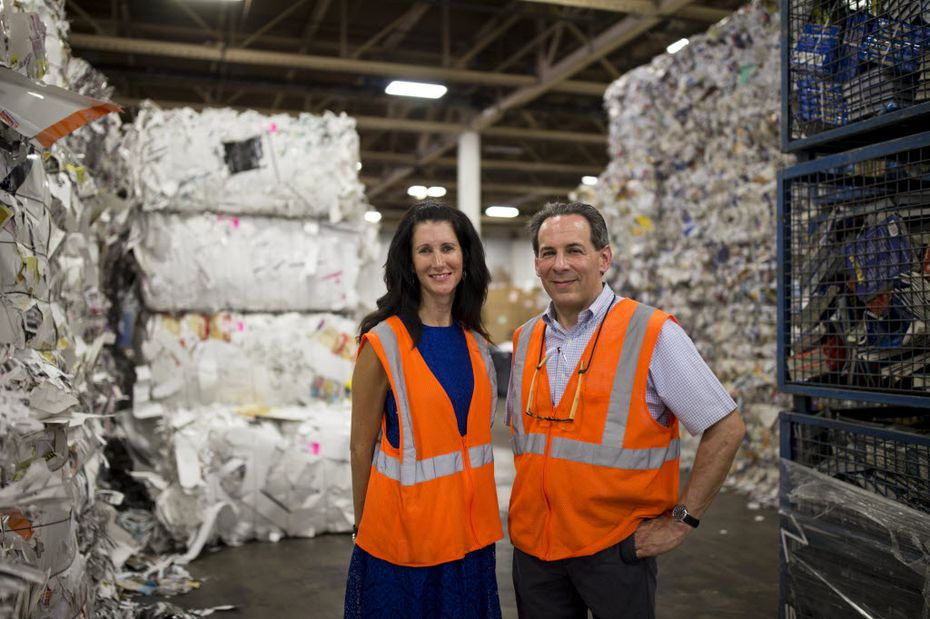 Texas Recycling vice president of sales Kathy DeLano (left), and president and co-owner Joel Litman poses for a portrait in the Texas Recycling plant on July 27, 2016 in Dallas. (Ting Shen/The Dallas Morning News)