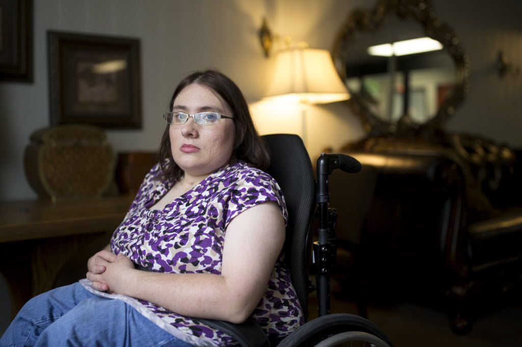 Shelley Olson, 31, a student of El Centro College poses for a portrait at Friendship Towers on July 15, 2016 in Dallas, Texas. Olson is 5 classes away from earning a paralegal associates degree in El Centro College before the shooting happened on July 7th. (Ting Shen/The Dallas Morning News)