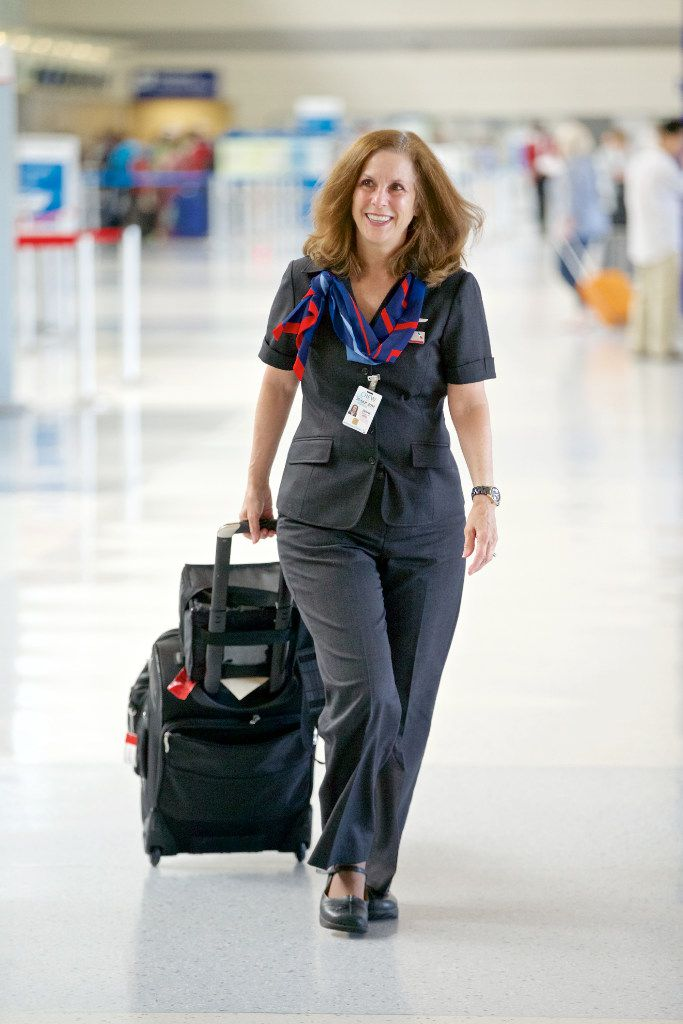 American Airlines Flight Attendant Diane Huisenga, wearing one of the airline's new uniforms, heads to her flight to Hong Kong at DFW Airport, Tuesday, September 20, 2016. (Brandon Wade/Special Contributor)