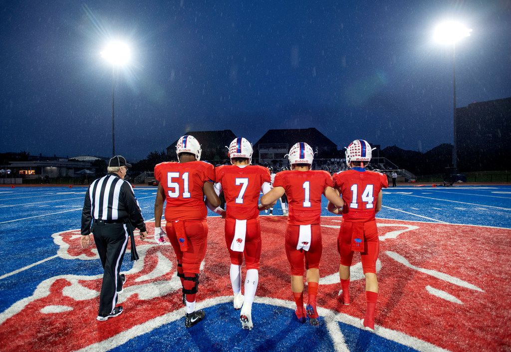 Parish Episcopal captains Jalen North (51), Tyler Hamilton (7), Parker Stone (1), and Logan Rayburn (14) walk to midfield for the coin toss before a high school football game against Bishop Lynch on Friday, October 19, 2018 at Gloria H. Snyder in Dallas.  Parish won 27-20. (Jeffrey McWhorter/Special Contributor)