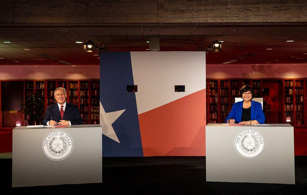 Republican Gov. Greg Abbott and his Democratic challenger, Lupe Valdez, smile before their debate  in Austin.