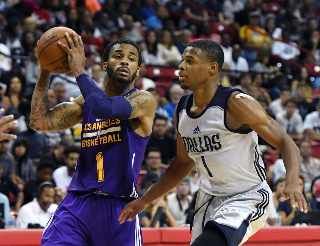 LAS VEGAS, NV - JULY 16:  Vander Blue #1 of the Los Angeles Lakers looks to pass under pressure from Dennis Smith Jr. #1 of the Dallas Mavericks during a semifinal game of the 2017 Summer League at the Thomas & Mack Center on July 16, 2017 in Las Vegas, Nevada. Los Angeles won 108-98. NOTE TO USER: User expressly acknowledges and agrees that, by downloading and or using this photograph, User is consenting to the terms and conditions of the Getty Images License Agreement.  (Photo by Ethan Miller/Getty Images)