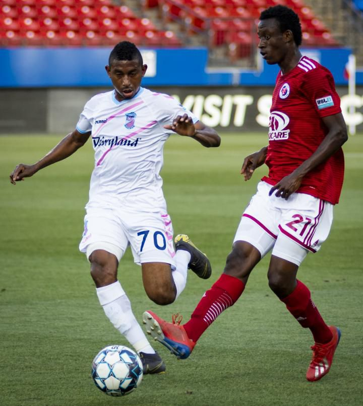 #21 Bicou Bissainthe of North Texas SC passes the ball against Forwrd Madison in USL League One play. (5-22-19)