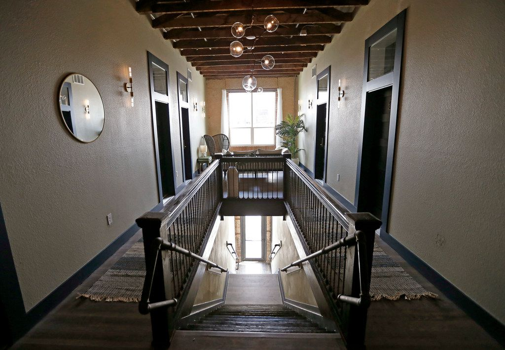The stairs shot from the second floor at Deep Ellum Hostel in Dallas, Thursday, July 12, 2018. (Jae S. Lee/The Dallas Morning News)