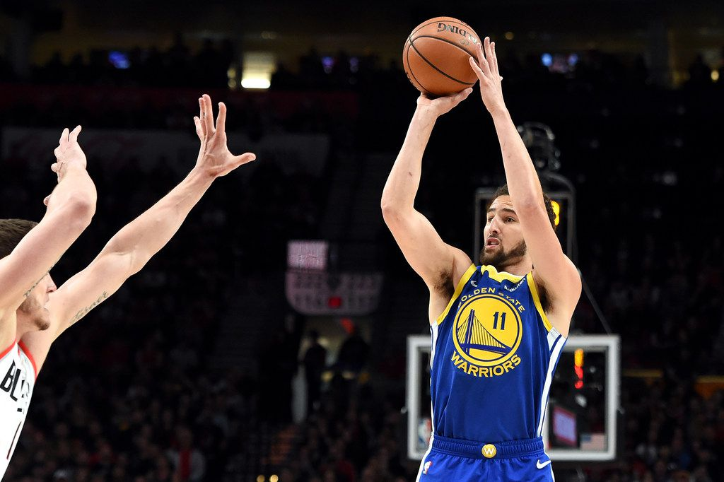 PORTLAND, OREGON - MAY 18: Klay Thompson #11 of the Golden State Warriors shoots the ball against Meyers Leonard #11 of the Portland Trail Blazers during the first half in game three of the NBA Western Conference Finals at Moda Center on May 18, 2019 in Portland, Oregon. NOTE TO USER: User expressly acknowledges and agrees that, by downloading and or using this photograph, User is consenting to the terms and conditions of the Getty Images License Agreement. (Photo by Steve Dykes/Getty Images)