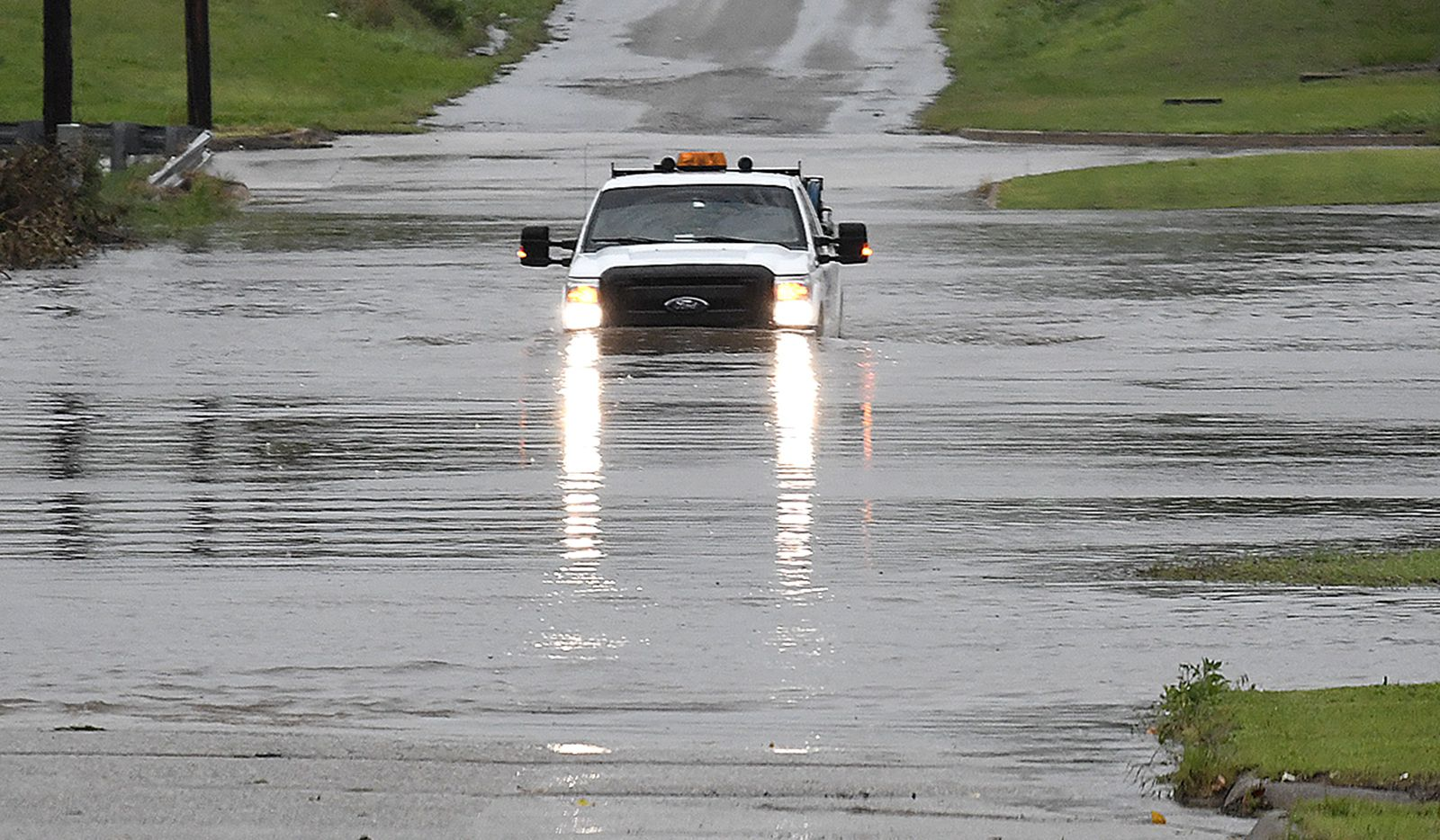 "A pickup drives on a flooded street in Enid, Okla., on Monday, May 20, 2019. An intense storm system that weather forecasters labeled ""particularly dangerous"" swept through the Southern Plains Monday, spawning a few tornadoes that caused some damage and a deluge of rain but no reports of injuries. (Billy Hefton/The Enid News & Eagle via AP)"