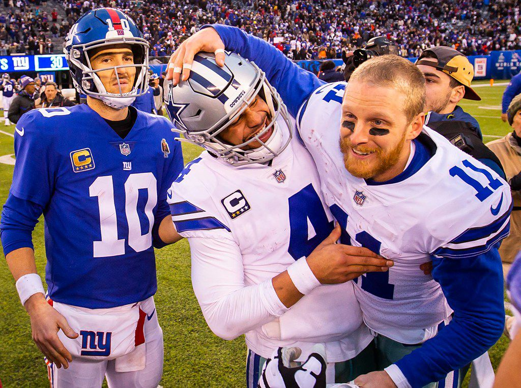 FILE - Cowboys quarterback Dak Prescott (4) celebrates with receiver Cole Beasley (11) after a 36-35 victory over the Giants and quarterback Eli Manning (10) at MetLife Stadium on Sunday, Dec. 30, 2018, in East Rutherford, N.J. (Smiley N. Pool/The Dallas Morning News)