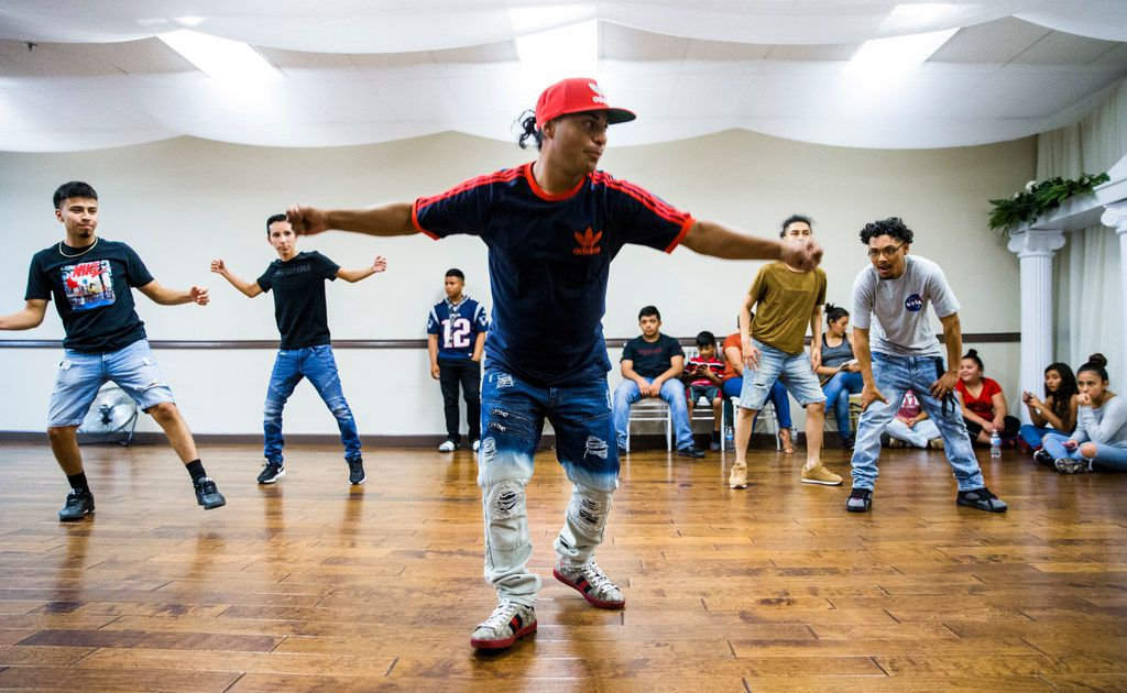 Lucky Franco (center) teaches the Latin Boyz Cadets dancers some new moves during a rehearsal at the Oasis Ballroom in Irving.
