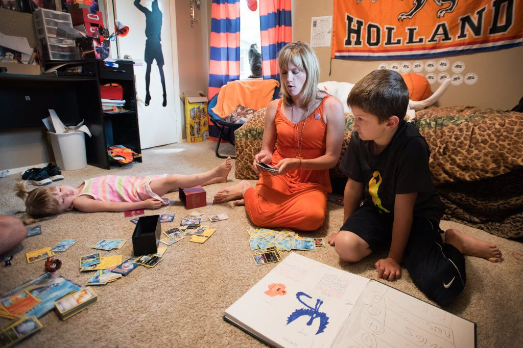 Max Briggle plays with mother, Amber Briggle, and sister, LuLu Briggle, in their Denton home on May 15, 2016.