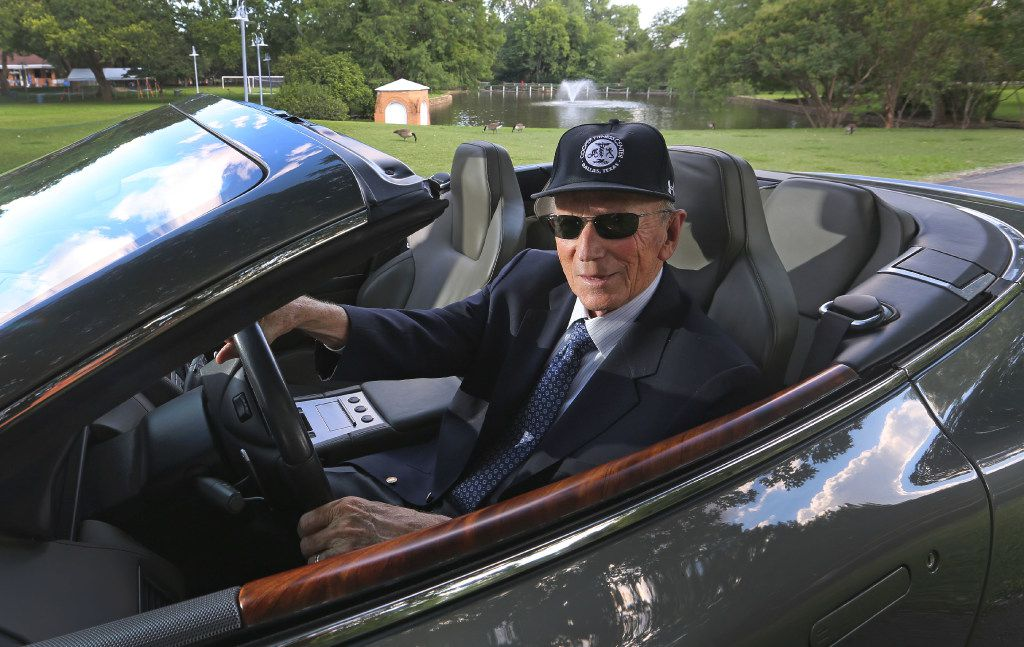 Dr. Kenneth Cooper and his Aston Martin at the Cooper Aerobic Center in Dallas