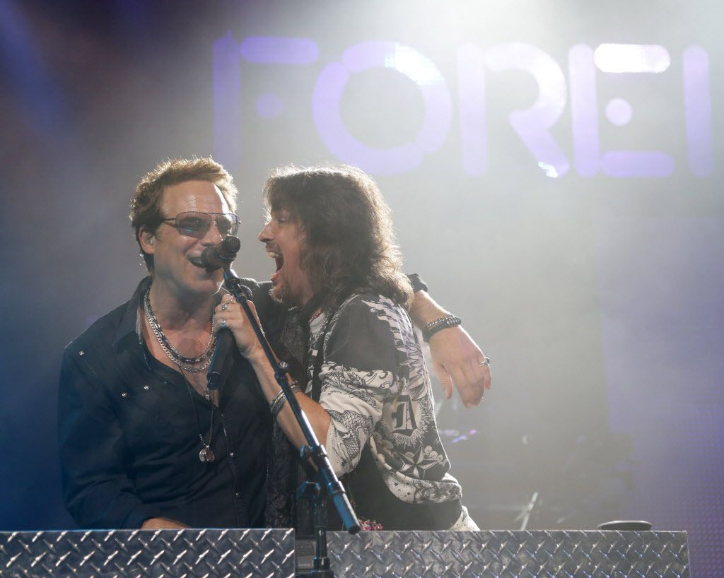 Foreigner's Tom Gimbel (left) and Kelly Hansen (right) perform at Verizon Theatre in Grand Prairie, Texas on Saturday, May 17, 2014.
