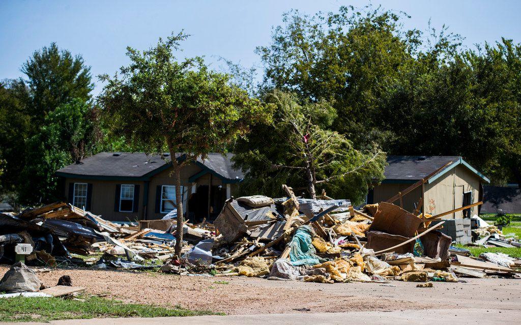 Debris remained piled up this week in the Colorado Landing RV Park in La Grange.