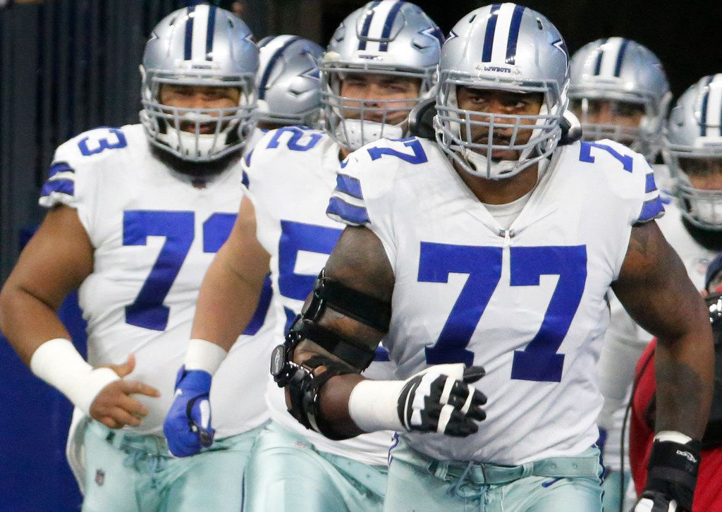 Dallas Cowboys offensive tackle Tyron Smith (77) is pictured with teammates during the Dallas Cowboys vs. the Indianapolis Colts NFL football game at Lucas Oil Stadium in Indianapolis on Sunday, December 16, 2018. (Louis DeLuca/The Dallas Morning News)