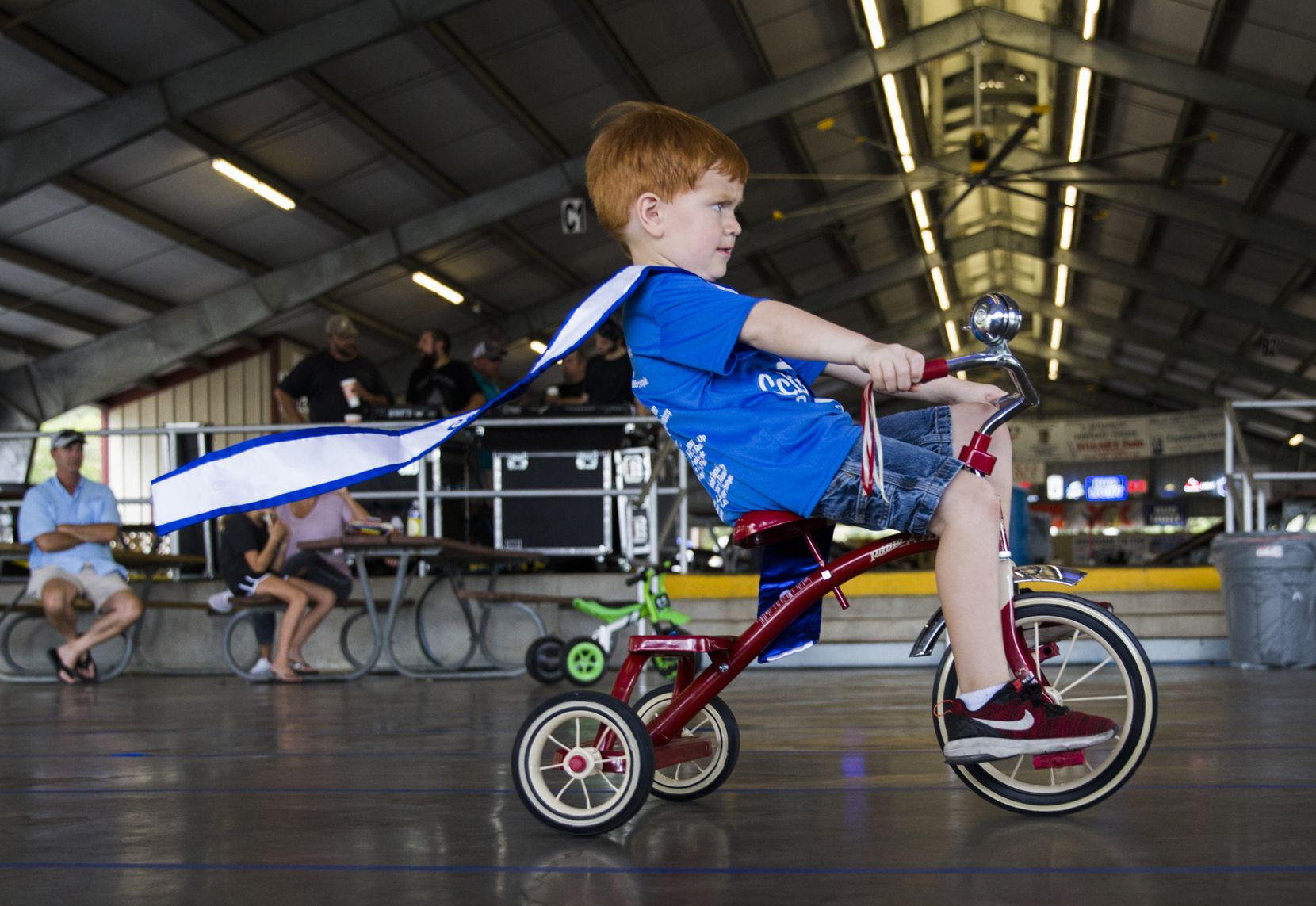 Little Mister Schulenburg Clay Hoffman, 4, participates in the tricycle races during the 2018 Schulenburg Festival on August 4, 2018 at Walters Park in Schulengburg, Texas.