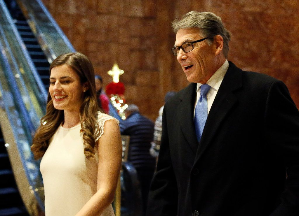 Former Texas Gov. Rick Perry enters Trump Tower with Trump aide Madeleine Westerhout for a meeting with President-elect Donald Trump on Monday. (Kathy Willens/Associated Press)