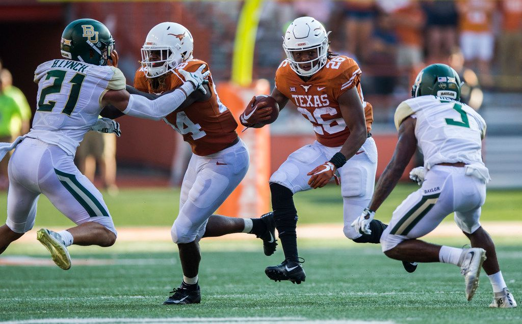 Texas Longhorns running back Keaontay Ingram (26) runs the ball during the third quarter of a college football game between Baylor and the University of Texas on Saturday, October 13, 2018 at Darrell K Royal Memorial Stadium in Austin, Texas.  (Ashley Landis/The Dallas Morning News)