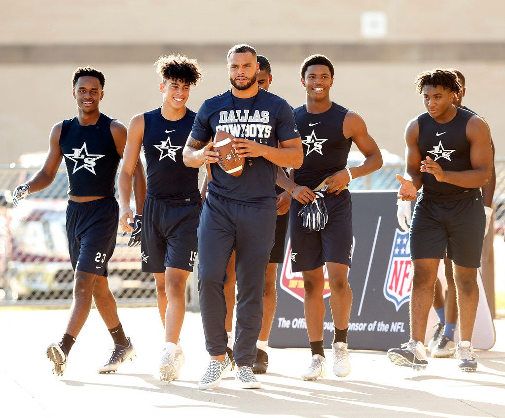 Dallas Cowboys quarterback Dak Prescott (center) joined Lone Star High School football players to film a Chunky Soup commercial at the schools practice field, Monday, September 17, 2018. (Tom Fox/The Dallas Morning News)