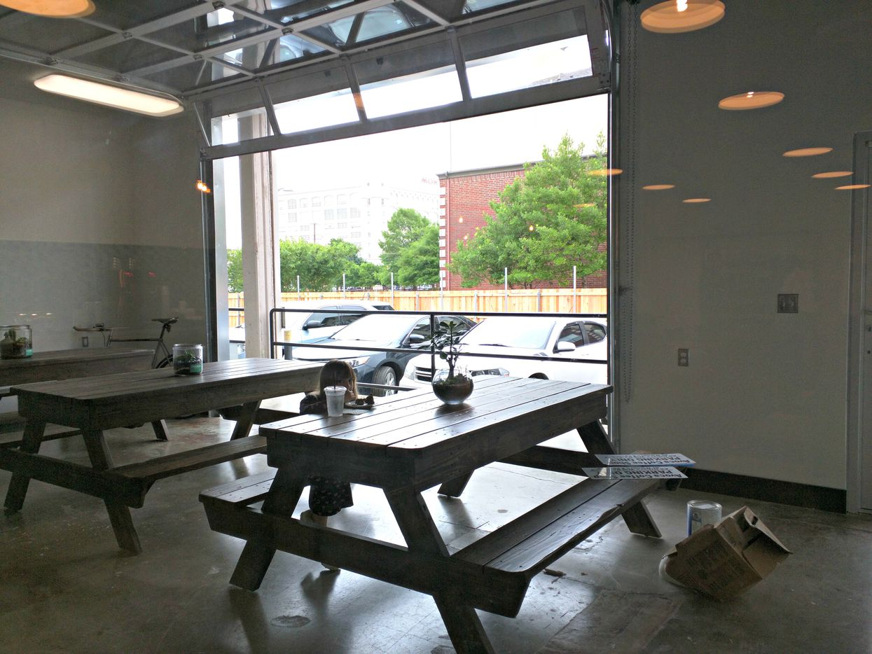 The West 7th location features an enclosed patio with a sliding garage door.