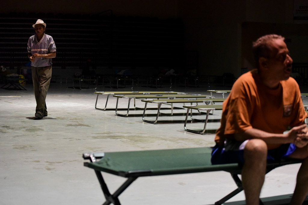 Citizens rest while waiting at Humacao Arena refugee center for the imminent impact of Maria, a Category 5 hurricane that threatens to hit the eastern region of the island with sustained winds of 175 miles per hour, in Humacao, Puerto Rico, Tuesday, September 19, 2017. About 137 citizens arrived at the refuge from different parts of the eastern region of the Island. (AP Photo/Carlos Giusti)