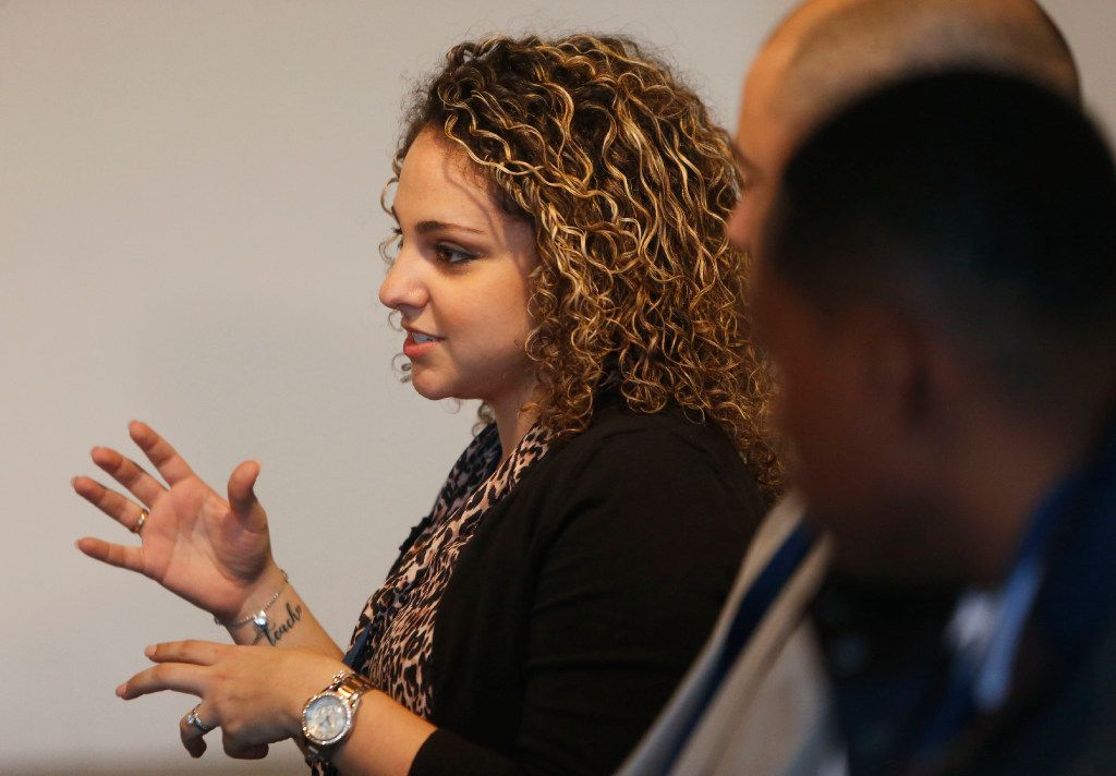 Voula Stephanou, a math teacher at West Mesquite High School, talks to students about becoming a teacher during the Extra Yard for Teachers Legacy Summit at SMU in Dallas on Wednesday, Jan. 11, 2017. (Rose Baca/The Dallas Morning News)