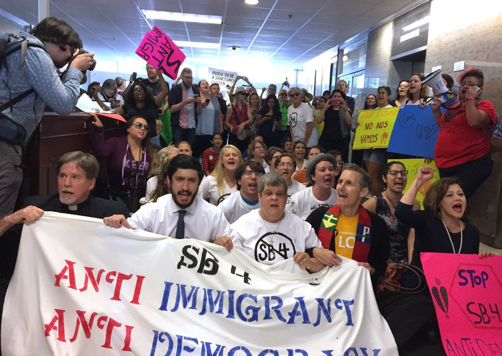 Protesters hosted a sit-in in the lobby of the State Insurance Building, where Gov. Greg Abbott's office is, on May 1, in opposition to Senate Bill 4.