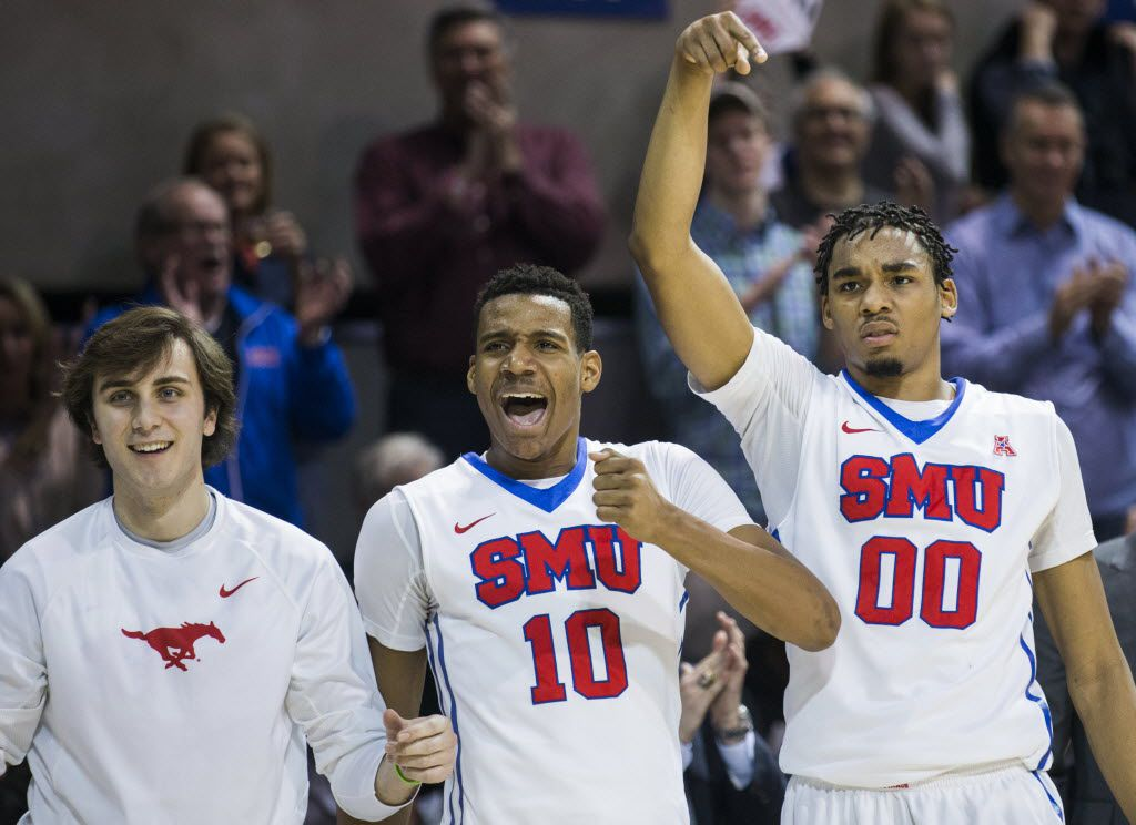 Southern Methodist Mustangs guard Jonathan Wilfong (22), guard Jarrey Foster (10) and forward Ben Moore (00) celebrate a point during the second half of their game against the Memphis Tigers on Saturday, January 30, 2016 at Moody Coliseum in Dallas.  (Ashley Landis/The Dallas Morning News)
