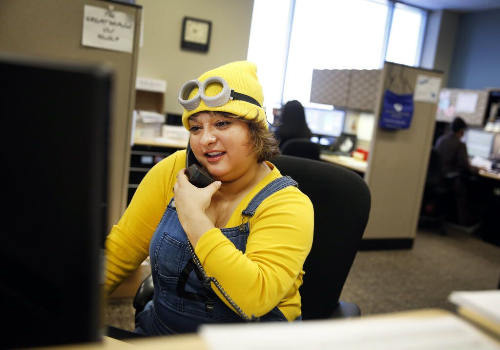 Patient coordinator team leader Lori Perez takes a call at her desk dressed as a Minion.