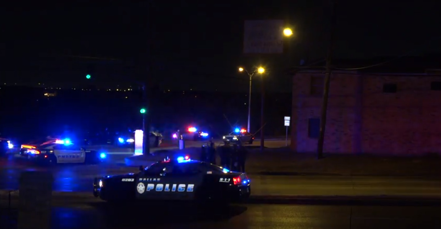 Dallas police at the scene of a fatal officer-involved shooting in which multiple officers fired at a male suspect, who later died at a hospital.