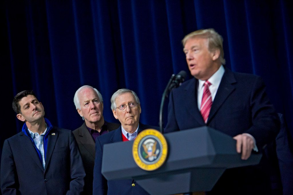 From left: Republican Sens. Paul Ryan, speaker of the House, John Cornyn and Mitch McConnell, Senate majority leader, listen to President Donald Trump speak at Camp David, Md.