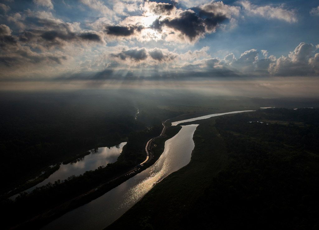 The Trinity River reflects the sun through the clouds over the Great Trinity Forest, on Tuesday, September 13, 2016 in south east Dallas. (Ashley Landis/The Dallas Morning News)