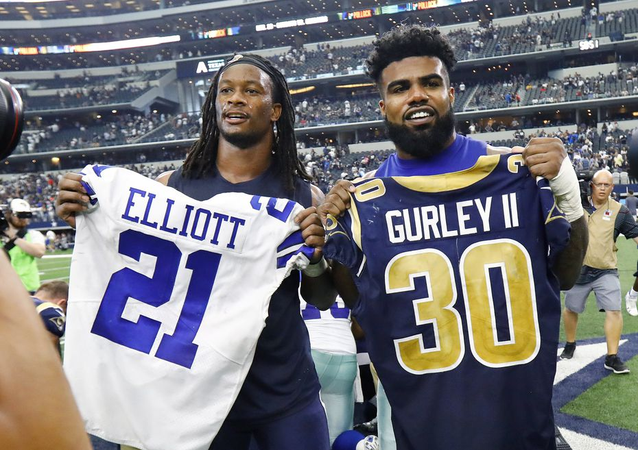 Ezekiel Elliott and Todd Gurley exchange jerseys after a game at AT&T Stadium in Arlington, Texas, Sunday, October 1, 2017.