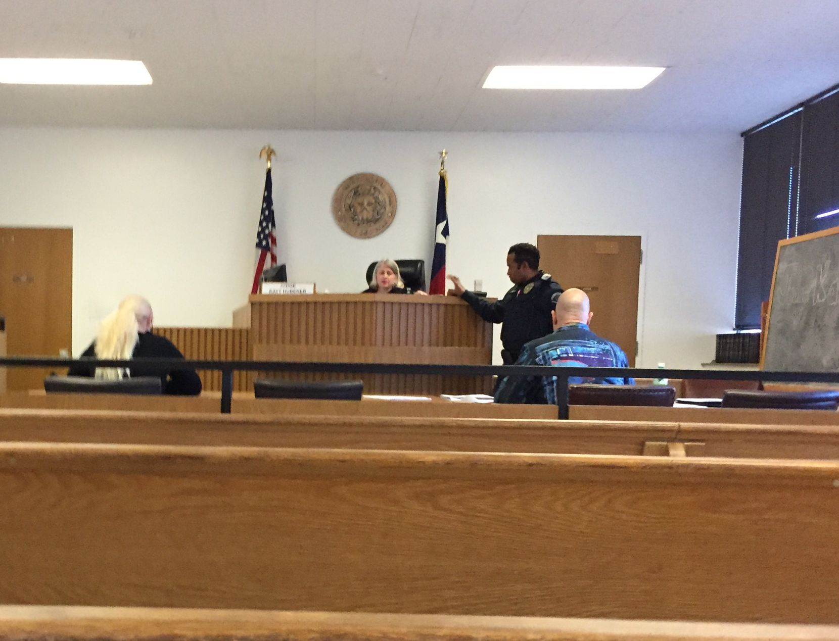 Christal Scott (left) fought 1and2 Automotive owner David A. Kost Jr. (right) in Irving Justice of the Peace Katy Hubener's courtroom.