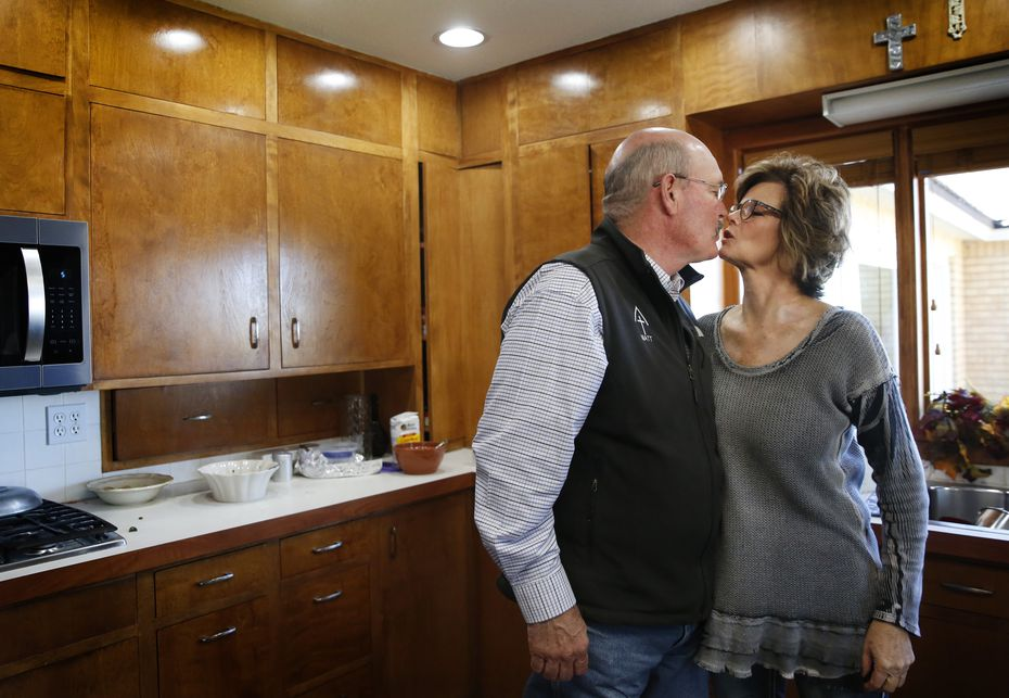Matt Farmer kisses his wife, Dianne, after lunch at their home in Lamesa.